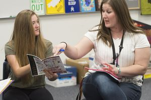 (Rick Egan  |  The Salt Lake Tribune)   Lily Larsen gets some help for drama teacher Kristie Wallace, at Jordan Schol District's Elk Ridge Middle School in South Jordan on Thursday.  District officials announced a new pay package for teachers in hopes of remaining competitive with surrounding districts amid a statewide teacher shortage.  Tasia Maes