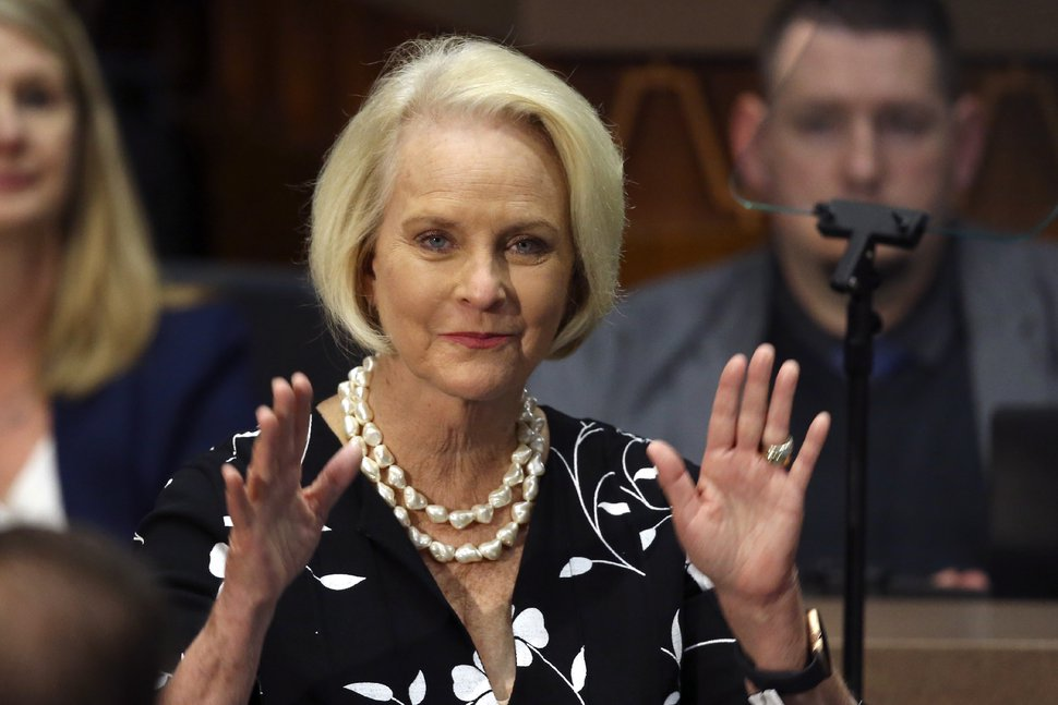 FILE - In this Jan. 13, 2020, file photo Cindy McCain, wife of former Arizona Sen. John McCain, waves to the crowd after being acknowledged by Arizona Republican Gov. Doug Ducey during his State of the State address on the opening day of the legislative session at the Capitol in Phoenix. (AP Photo/Ross D. Franklin, File)