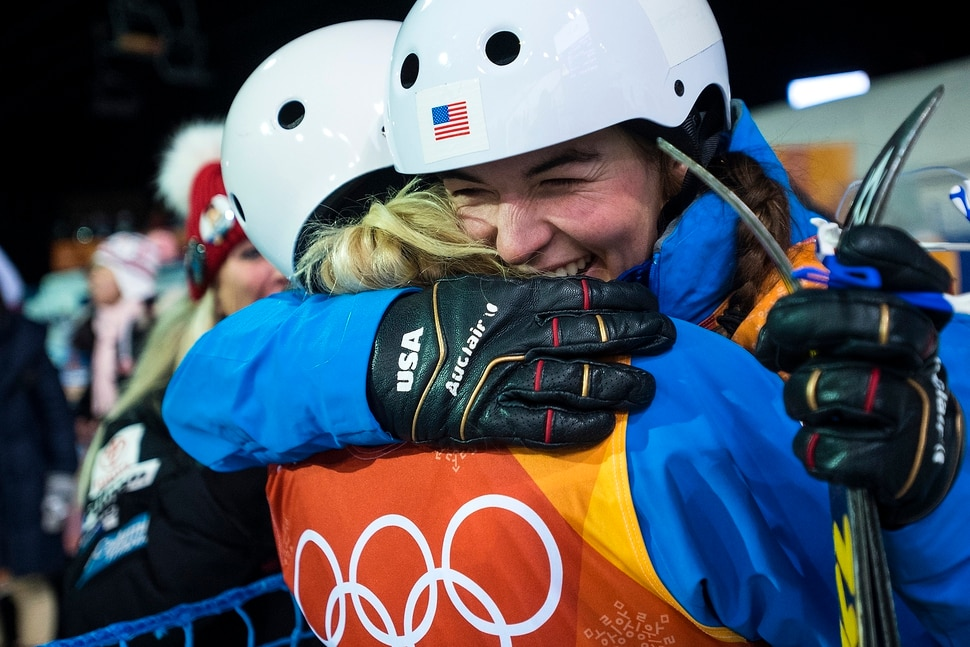 (Chris Detrick | The Salt Lake Tribune) USA's Kiley McKinnon, left, and USA's Madison Olsen hug after learning they both qualified for the finals during the Ladies' Aerials Qualification at Phoenix Park during the Pyeongchang 2018 Winter Olympics Thursday, Feb. 15, 2018.