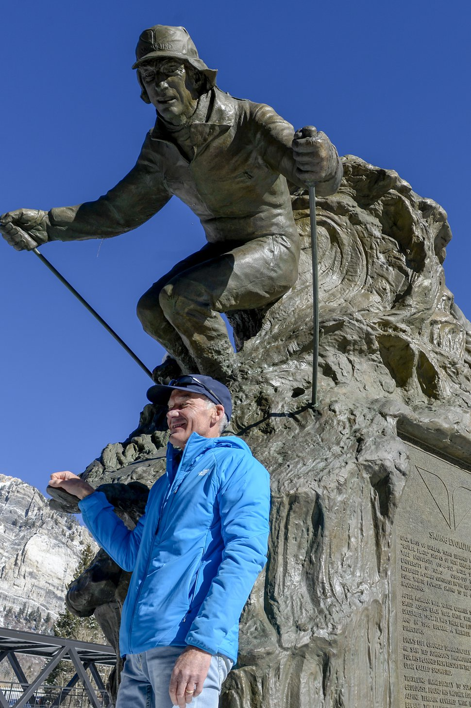 Leah Hogsten | The Salt Lake Tribune Bob Bonar, who worked alongside the late Snowbird Ski and Summer Resort owner Dick Bass since before the resort opened in 1971, poses next to the recently placed bronze statue of Bass.