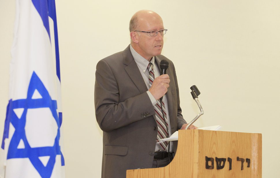 In this picture taken Dec. 8, 2014, and released by Yad Vashem, Holocaust historian Jan Grabowski gives a speech at Yad Vashem, the Israeli Holocaust research center, during a ceremony in which he was awarded for his scholarship, in Jerusalem, Israel. Dozens of international historians have come to the defense of the Holocaust scholar who is being accused of slandering Poland's reputation with research that focuses on the participation of some Poles in the killing of Jews during World War II. The Polish League Against Defamation said last month that Jan Grabowski's scholarship