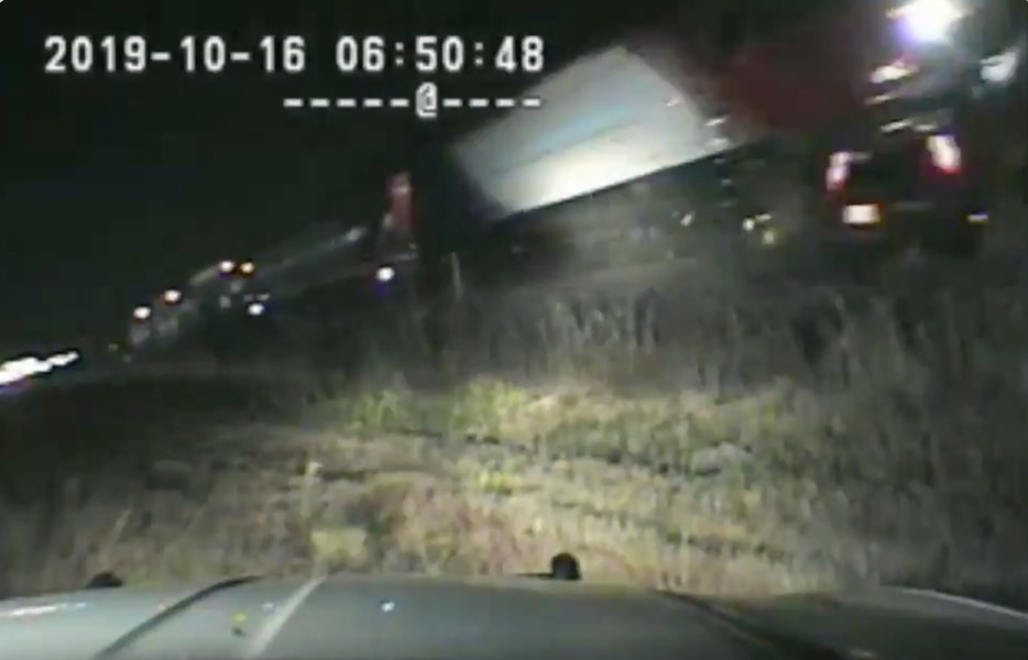 UHP trooper pulls motorist from car just before it's destroyed by a FrontRunner train