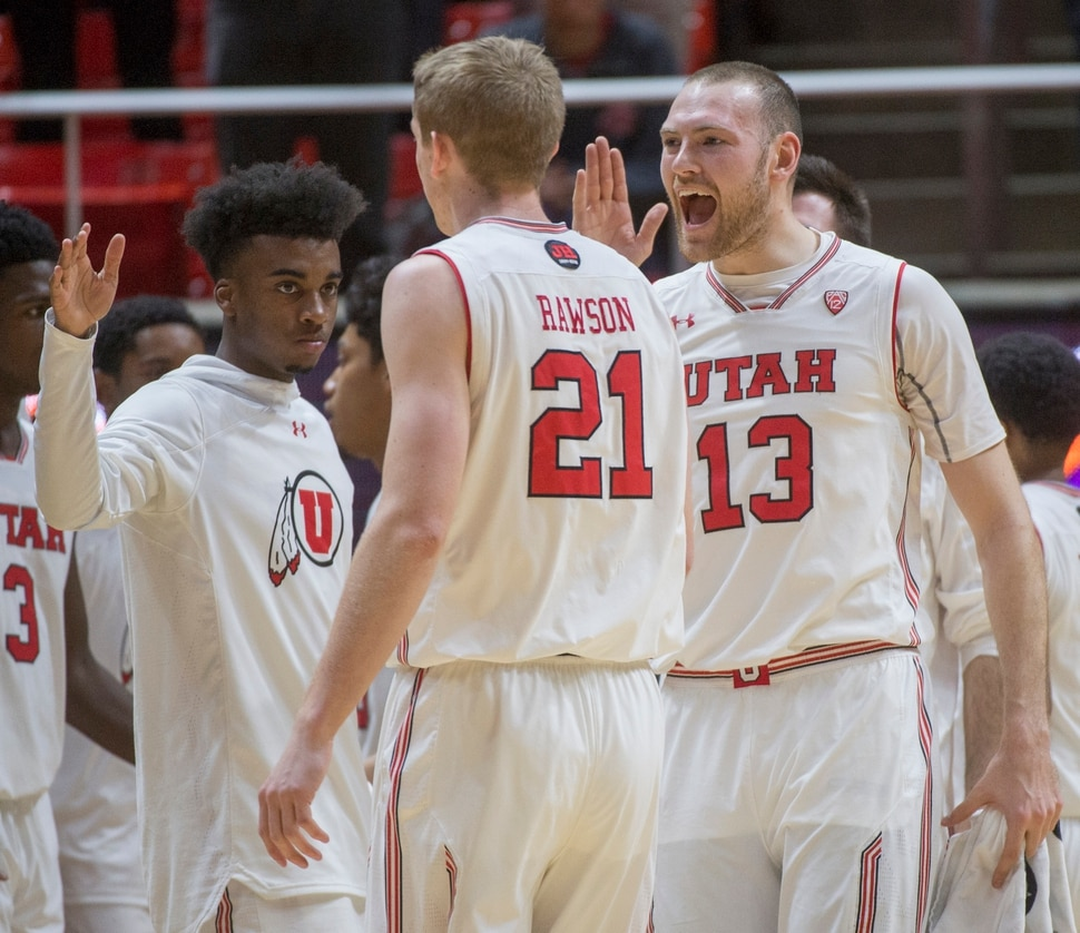 (Rick Egan | The Salt Lake Tribune) Utah Utes guard Kolbe Caldwell (2), Utah Utes forward Tyler Rawson (21) and Utah Utes forward David Collette (13)celebrates as the Utes take a 27-9 lead in the first quarter, in NIT playoff action between Utah Utes and LSU Tigers at the Jon M. Huntsman Center, Monday, March 19, 2018.