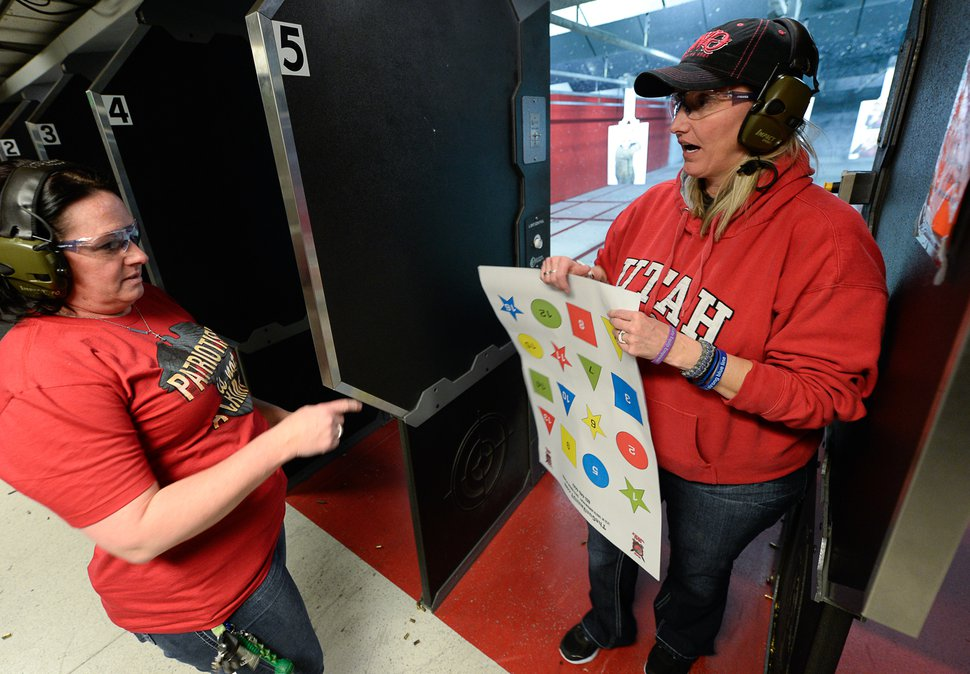 (Francisco Kjolseth   The Salt Lake Tribune) Melanie Lewis, left, and Connie Peterson, members of The Well-Armed Woman club, gather at The Gun Vault shooting range in South Jordan during a monthly training.