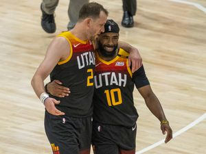 (Rick Egan | The Salt Lake Tribune) Utah Jazz guards Joe Ingles and Mike Conley embrace during a break in the action in Game 2 of NBA Playoffs at Vivint Arena on Wednesday, May 26, 2021. The teammates could face each other at the Tokyo Olympics if Conley is named to Team USA. Ingles will play for the Boomers, the Australian national team.