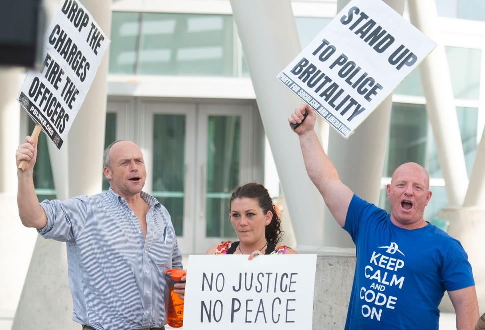 (Rick Egan | The Salt Lake Tribune) Protesters shout stand up fight back during a rally sponsored by Utah Against Police Brutality, which included several protesters that talked about their experience being attacked by Salt Lake City Policemen, at the Inland port protest. Tuesday, July 23, 2019.