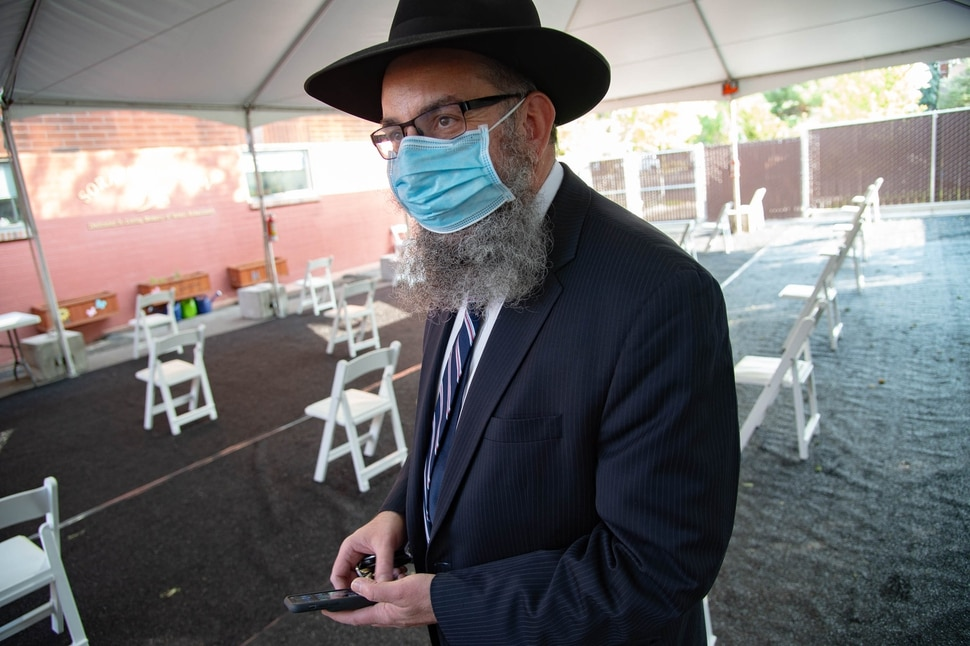 (Francisco Kjolseth | The Salt Lake Tribune) Rabbi Benny Zippel goes over safety set up plans with outdoor tents on Thursday, Sept. 17, 2020, for High Holy Day services, which begin Friday evening, so members of Chabad Lubavitch can meet in person, outside and socially distanced through the weekend.