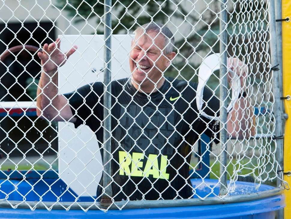 (Rick Egan | The Salt Lake Tribune) Danny Ainge reacts after being dunked in a dunking booth, at a fundraiser in Provo for his son Tanner Ainge, who is running for congress, in Utah's third district. Monday, August 7, 2017.