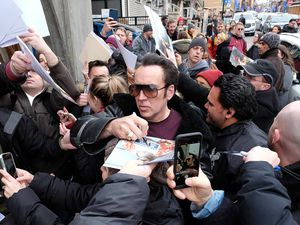 (Francisco Kjolseth  |  The Salt Lake Tribune)  Actor Nicolas Cage is mobbed by fans as the 2018 Sundance Film Festival kicks off along Main Street in Park City on Friday, Jan. 19, 2018.