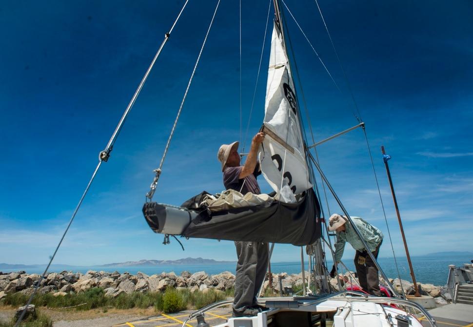 (Rick Egan | The Salt Lake Tribune) Rick Hoffman and Greg Wilson work on a boat at the Great Salt Lake Marina, Tuesday, June 11, 2019.