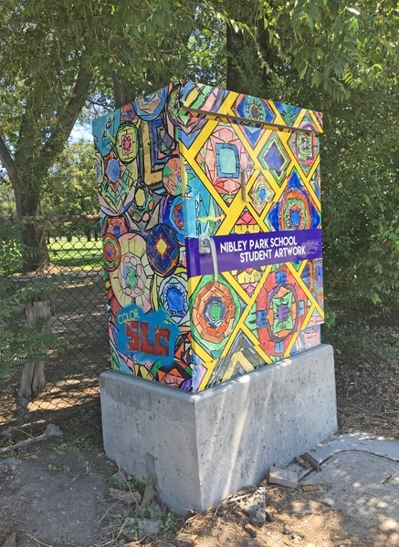 (Photo courtesy Salt Lake City Mayor's Office) A utility box near Nibley Park Elementary School in Salt Lake City, decorated with artwork by the school's students, as part of the city's ColorSLC program.