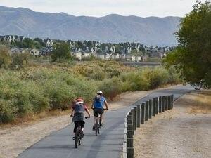 (Francisco Kjolseth     The Salt Lake Tribune) Cyclists pedal on the Jordan River Parkway in South Jordan on Friday, Oct. 2, 2020.
