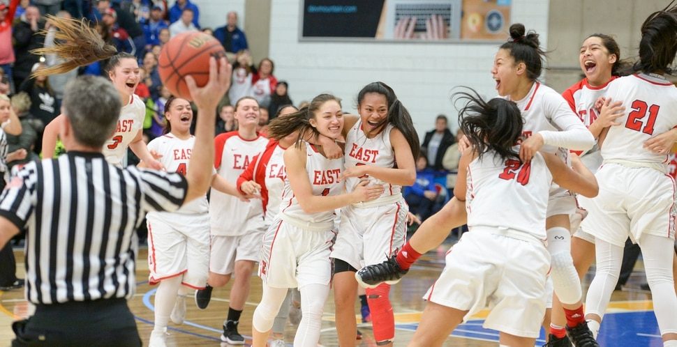 (Leah Hogsten | The Salt Lake Tribune) East celebrates the win. East defeated Timpview 68-48 to win the the 5A High School Girls' Basketball Tournament title at SLCC in Taylorsville, Saturday, Feb. 24, 2018.