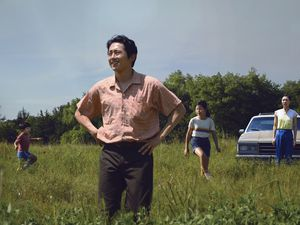 "(David Bornfriend  |  A24) Steven Yeun, foreground, plays the patriarch of a Korean-American family starting a farm in Arkansas, in writer-director Lee Isaac Chung's drama ""Minari."" The Utah Film Critics Association named ""Minari"" the best movie of 2020."