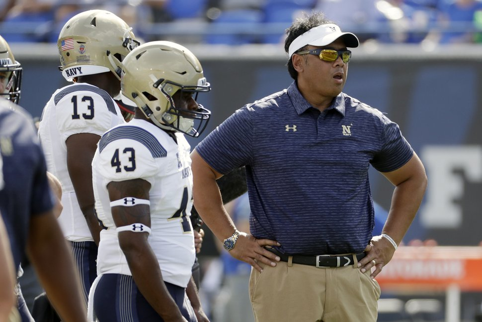 """FILE - In this Oct. 14, 2017, file photo, Navy head coach Ken Niumatalolo watches as players warm up before an NCAA college football game against Memphis, in Memphis, Tenn. A year ago, Navy was on a roll when it faced Southern Methodist. That game seems so far away now. I wish we could play like that again,"""" Niumatalolo said. """"They're much improved, and we're not as good."""" (AP Photo/Mark Humphrey, File)"""