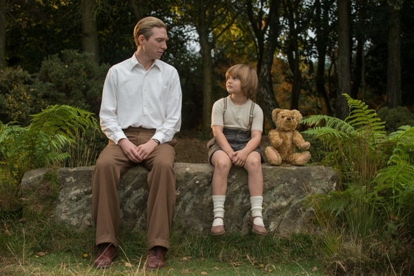 (David Appleby | Fox Searchlight Pictures) Author A.A. Milne (Domhnall Gleeson, left) finds inspiration from his son, Christopher Robin (Will Tilston) and his toys, in the drama