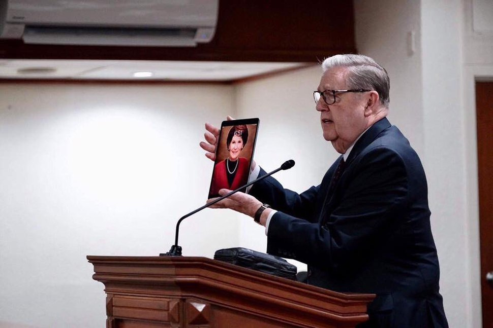 "(Photo courtesy of The Church of Jesus Christ of Latter-day Saints) Apostle Jeffrey R. Holland displays his iPad screen saver, a photograph of his wife, Patricia Terry Holland, during a Jan. 17, 2019, devotional in the Philippines. ""That's my screen saver,"" he said, ""but more than that, that's my lifesaver."""
