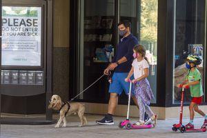 (Rick Egan  |  The Salt Lake Tribune)    Pedestrians wear masks in downtown Salt Lake City, Tuesday, Sept. 29, 2020.