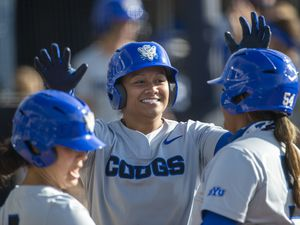 (Tyler Tate | AP) BYU infielder Martha Epenesa (center) celebrates with teammates Marissa Chavez (left) and Huntyr Ava (right) after a home run during an NCAA softball game on Friday, April 23, 2021 in Provo.