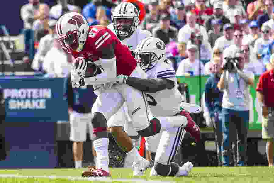 Badgers bludgeon Cougars defense with the run and pass