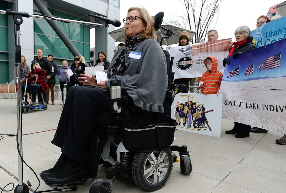 (Francisco Kjolseth | The Salt Lake Tribune) Bonnie Mitchell who has Ehlers Danlos Syndrome, an inherited connective tissue disease lends her voice to speak out over the current tax plan being discussed that eliminates the deception for medical expenses and long term care. A group of Utahns gathered to rally at the Wallace Bennett Federal Building in Salt Lake on Monday, Nov. 20, 2017, to tell personal stories of how they might be impacted by the tax reform plans currently on the table in Congress.