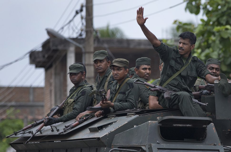 (Gemunu Amarasinghe | The Associated Press) Soldiers return to their base following an operation searching for explosives and suspects tied to a local group of Islamic State militants in Kalmunai, Sri Lanka, Monday, April 29, 2019. The Catholic Church in Sri Lanka on Monday has urged the government to crack down on Islamic extremists with more vigor