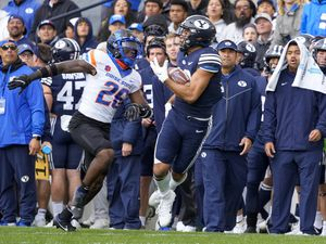 (Leah Hogsten | The Salt Lake Tribune) Brigham Young Cougars wide receiver Puka Nacua (12) pulls in the catch with Boise State Broncos cornerback Caleb Biggers (26) as No. 10 Brigham Young University hosts Boise State at LaVell Edwards Stadium, Oct. 9, 2021.