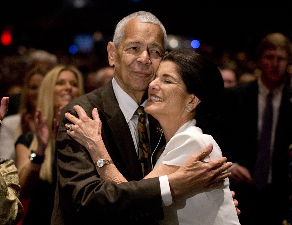 FILE- In this April 10, 2014, file photo, social activist Julian Bond hugs Luci Baines Johnson, the younger daughter of President Lyndon Baines Johnson after singing
