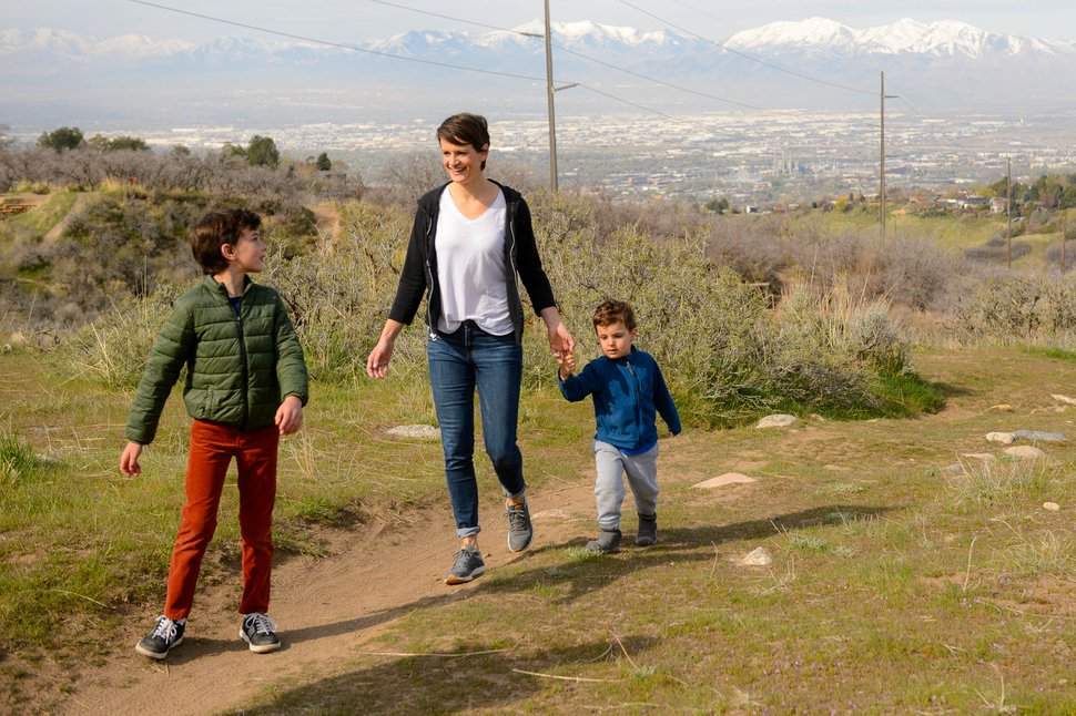 (Trent Nelson | The Salt Lake Tribune) Angela Dunn, state epidemiologist from the Utah Department of Health, on a walk with her family in the hills above Salt Lake City on Saturday, April 18, 2020. From left, Pierce Mendoza, Dunn, and Owen Mendoza.