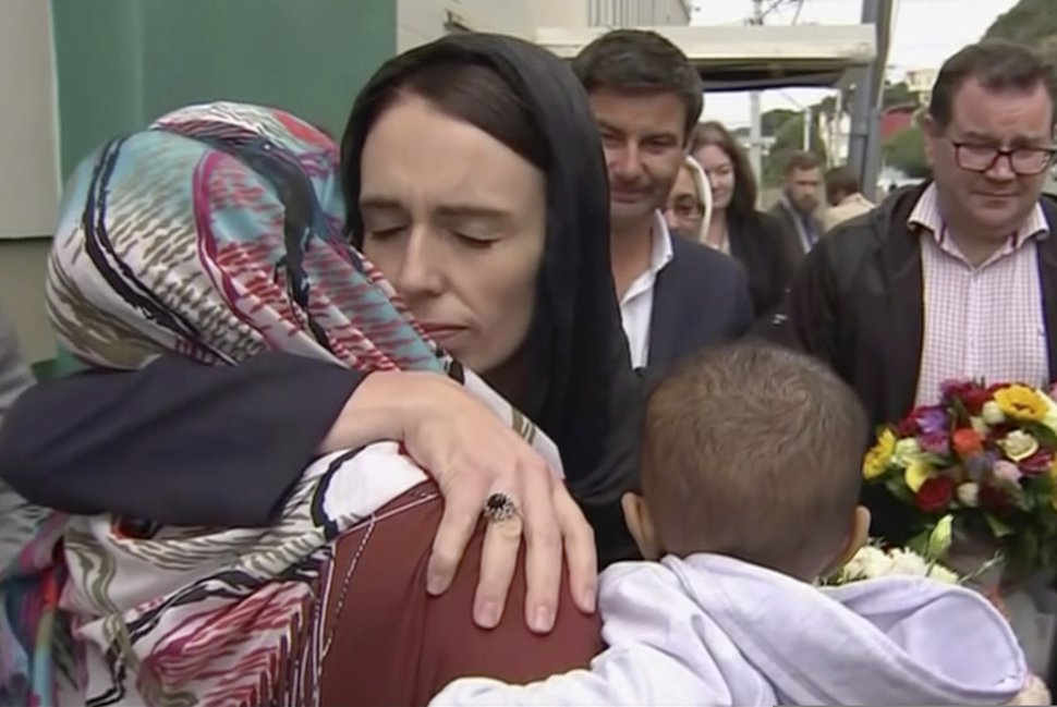 (TVNZ via AP) In this image made from video, New Zealand Prime Minister Jacinda Ardern, center, hugs and consoles a woman as she visited Kilbirnie Mosque to lay flowers among tributes to Christchurch attack victims, in Wellington, Sunday, March 17, 2019.