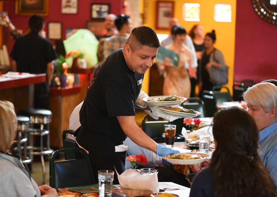 Francisco Kjolseth | The Salt Lake Tribune Ernesto Rodriguez serves guests at Red Iguana 2 during a recent lunch rush. Utah's most decorated restaurant, winning both local and national awards for its