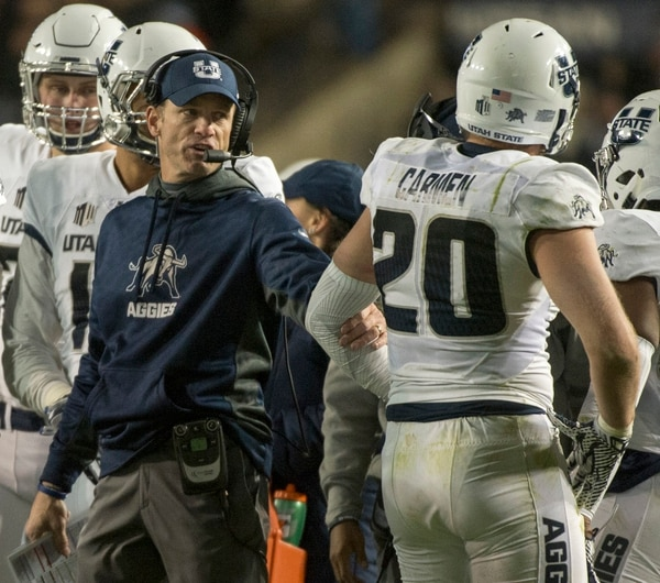 Rick Egan | The Salt Lake Tribune Utah State Aggies head coach Matt Wells has a few words with Utah State Aggies linebacker Brock Carmen (20) after he was called for a personal foul, in football action, BYU vs Utah State, at Lavell Edwards Stadium in Provo, Saturday, November 26, 2016.