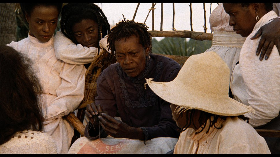 | courtesy Cohen Film Collection Nana (Cora Lee Day, center), matriarch of the Peazant family, dispenses advice to Haagar (Kaycee Moore, far left), Eula (Alva Rogers, center left), and Viola (Cheryl Lynn Bruce, right) in a scene from Julie Dash's 1991 drama