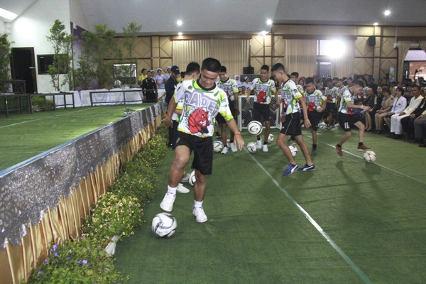 In this July 18, 2018, photo provided by Chiang Rai Public Relations Department, members of the rescued soccer team show their skills before a press conference regarding their experience being trapped in the cave in Chiang Rai, northern Thailand. The Thai soccer boys and their coach began their first day back home with their families since they were rescued from a flooded cave with a trip to a Buddhist temple on Thursday, July 19, to pray for protection from misfortunes. (Chiang Rai Public Relations Department via AP)