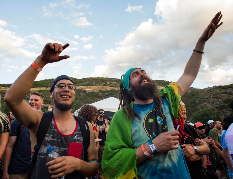(Rick Egan | The Salt Lake Tribune) Mori Ortiz, from Murray and Garrett Goodwill, from Logan, dance to the music of Stephen Marley as he plays the opening day of the 3-day Reggae Rise Up Festival at the Rivers Edge in Heber City, Friday, Aug. 24, 2018.