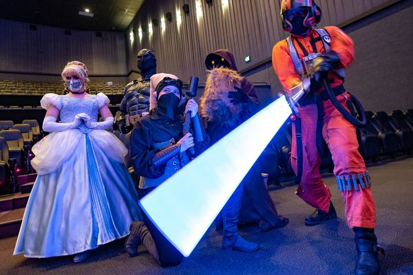 "(Francisco Kjolseth | The Salt Lake Tribune) Cosplay fans Bradi Webb, Travis Hysell, Coincidence Cosplay, Marial Clark and Eric Allan Hall, from left, pose for photographs following announcements by FanX of its plans for the September 2021 comic convention as they join the fun at Valley Fair Mall on Tuesday — International Star Wars Day (""May the Fourth Be With You""), 2021. The convention will be held at the Salt Palace Convention Center, Sept. 16-18, 2021."