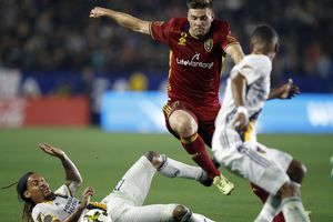 Real Salt Lake defender David Horst, center, leaps over the tackle by Los Angeles Galaxy midfielder Jermaine Jones (13) to get to the ball during the second half of an MLS soccer game in Carson, Calif., Saturday, Sept. 30, 2017. (AP Photo/Alex Gallardo)