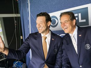 (Photo courtesy of John Paul Filo | CBS) Tony Romo and Jim Nantz will call the Super Bowl for CBS on Sunday, but they won't get this close to each other.