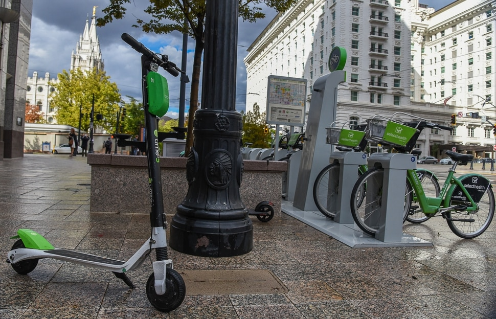 (Francisco Kjolseth | The Salt Lake Tribune) GreenBike was on track to have their best year yet but then Lime and Bird scooters derailed their momentum as both modes of transportation are seen in downtown Salt Lake City on Tuesday, Oct. 2, 2018.