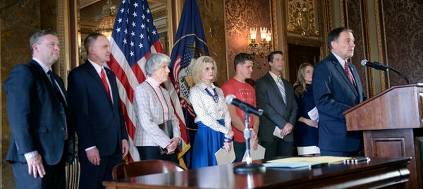 ( Al Hartmann | The Salt Lake Tribune ) Sen. Todd Weiler, R- Woods Cross and Rep. Craig Hall, R-West Valley City, left, stand with representatives of anti-pornography groups and Gov. Gary Herbert at the ceremonial signing of two pornography bills, SCR-9 and HB 155.
