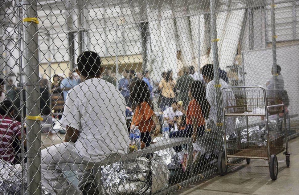 (U.S. Customs and Border Protection's Rio Grande Valley Sector via AP) In this June 17, 2018 file photo provided by U.S. Customs and Border Protection, people who've been taken into custody related to cases of illegal entry into the United States, sit in one of the cages at a facility in McAllen, Texas. Records obtained by The Associated Press highlight some of the problems that plague government facilities for immigrant youth.