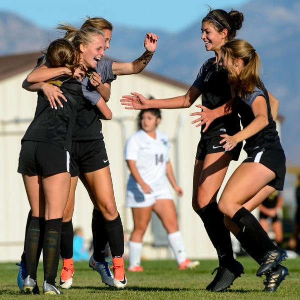 (Steve Griffin | The Salt Lake Tribune) Davis forward Lex Hibler, second from left, is swarmed by her teammates after she scored during the Class 6A girls' soccer playoff game at Copper Hills High School in West Jordan Tuesday October 10, 2017.