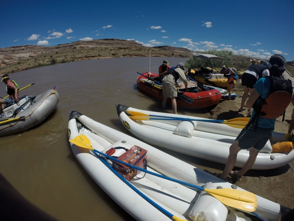 (Nate Carlisle | The Salt Lake Tribune) River runners launch rafts and inflatable kayaks onto the Colorado River at Dewey Bridge campground near Moab on May 27, 2017.