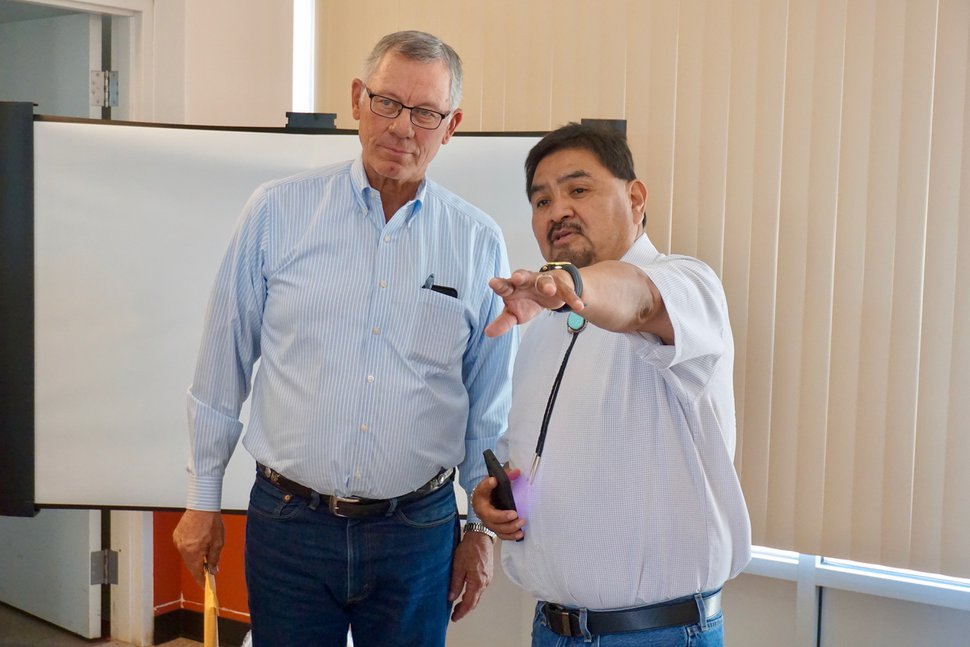 (Zak Podmore | Tribune file photo) Oljato Chapter President James Adakai, right, talks with San Juan County Commissioner Bruce Adams after a county commission meeting in Monument Valley, Utah, July 2, 2019.
