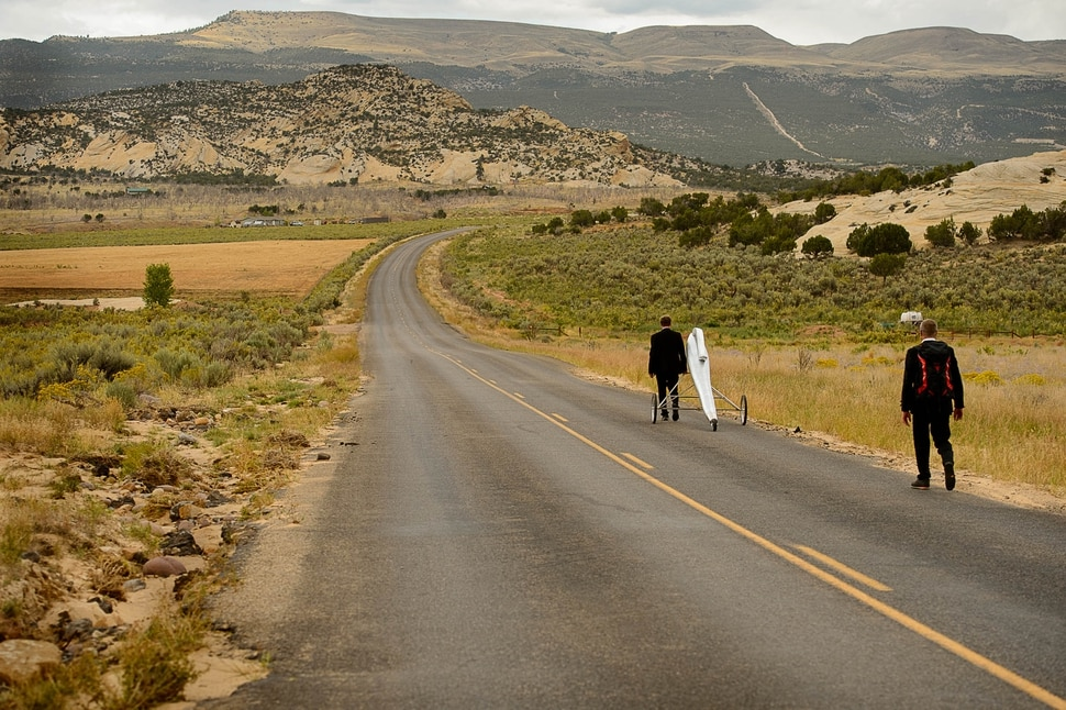 (Trent Nelson   The Salt Lake Tribune) German artists Thomas Huber and Wolfgang Aichner on the first day of their art project, Linear, about ten miles northwest of Vernal Wednesday September 13, 2017. The duo are launching a four-week long performance art project in which they are filming themselves dragging an oversized giant silver pen through a 250-mile rectangular through the deserts of Utah, Wyoming and Colorado.