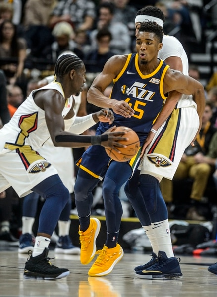 (Steve Griffin | The Salt Lake Tribune) Utah Jazz guard Donovan Mitchell (45) sneaks past a green set by New Orleans Pelicans forward Anthony Davis (23) during the the Utah Jazz versus the New Orleans Pelicans NBA basketball game at the Vivint Smart Home Arena in Salt Lake City Wednesday January 3, 2018.