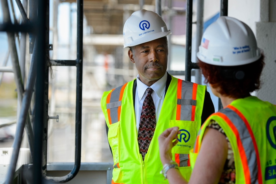 (Trent Nelson | The Salt Lake Tribune) Housing and Urban Development Secretary Ben Carson tours the HUB of Opportunity, a mixed-use real estate development located within an Opportunity Zone in Salt Lake City on Thursday July 11, 2019. The 200,00 square foot, HUD-supported facility is currently under construction. Giving Carson a tour of the site is Stephanie Mackay, at right.