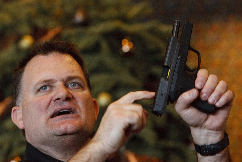 (Leah Hogsten | Tribune File Photo) A free concealed carry class for educators turned away over 50 people said concealed firearms instructor Clark Aposhian, of the Utah Shooting Sports Council. The course held at the Maverik Center in West Valley City was held Dec. 27, 2012.