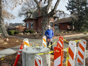 (Rick Egan | The Salt Lake Tribune) Dorothea Rosenberger stands next to the base for a 5G tower in front of her home  that is on the historic registry, on 1100 East, in Salt Lake City, on Tuesday, Jan. 5, 2021.