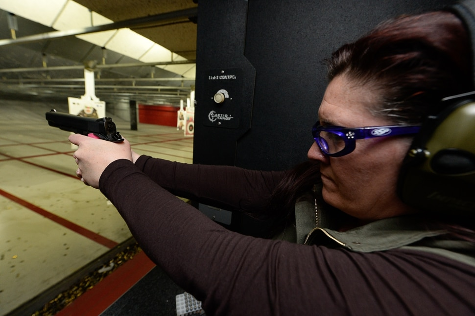 (Francisco Kjolseth | The Salt Lake Tribune) NRA-certified instructor Michelle Camp takes aim as she joins other women at The Gun Vault shooting range in South Jordan. Camp, a leader of the The Well-Armed Woman chapters in Utah, encourages women to conceal carry for safety and to keep their skills sharp. Of the concealed carry permits issued by the state, only about one in five is held by a woman.